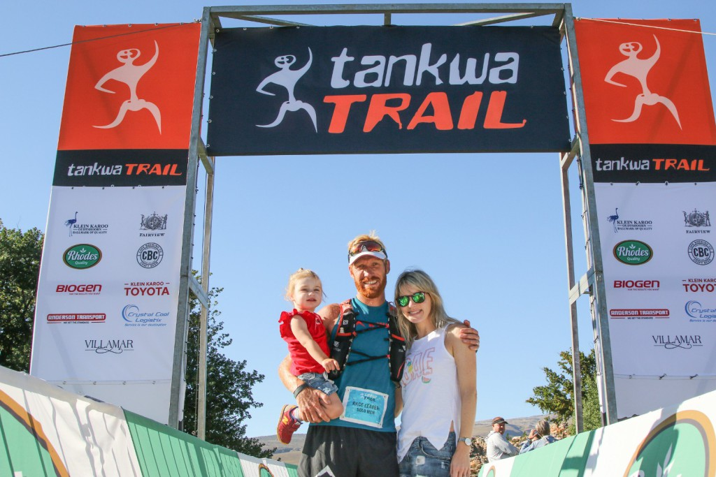 AJ Calitz poses with his daughter, Emilie, and wife, Paulette, after winning the 2017 Tankwa Trail. Photo by Oakpics.com.