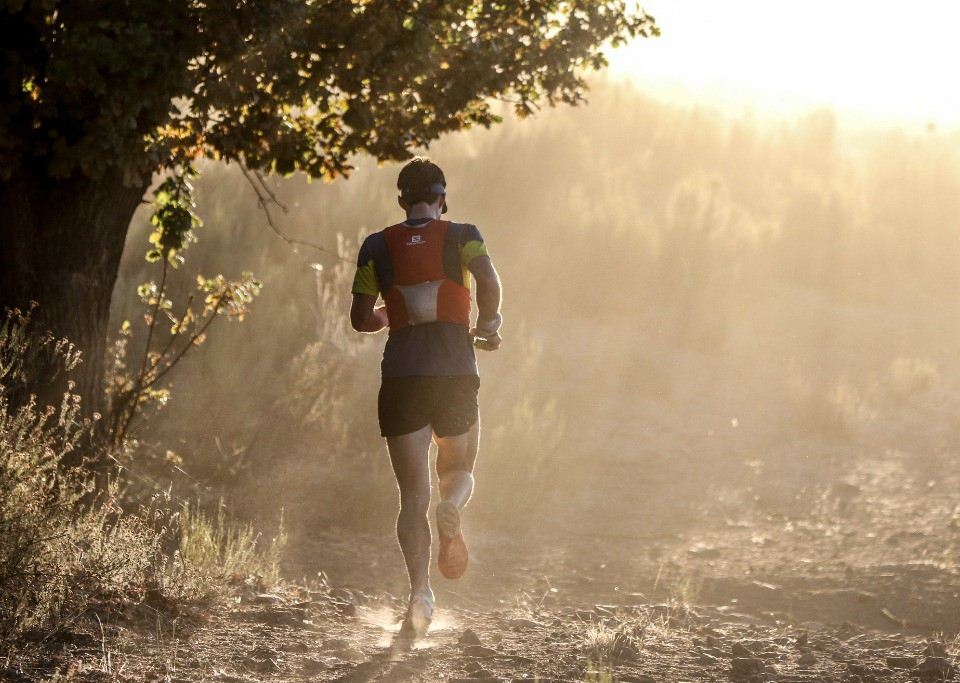 Chritiaan Greyling runs into the rising sun during Stage 1 of the Tankwa Trail. Photo by Oakpics.com.