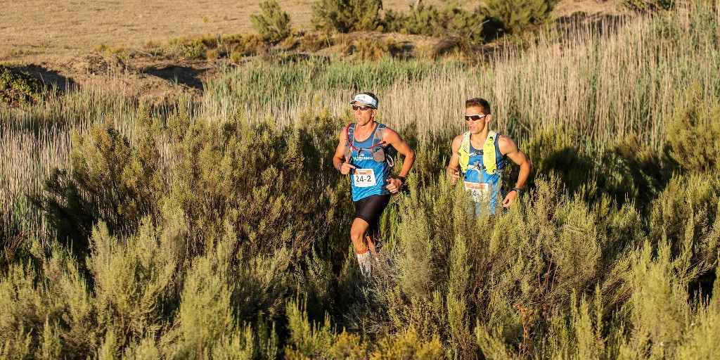 Mauritz Jansen van Rensburg (left) and J.C. Visser (right) of Team Soul Running on their way to victory in the men's team category during Stage 1 of the Tankwa Trail. Photo by Oakpics.com.