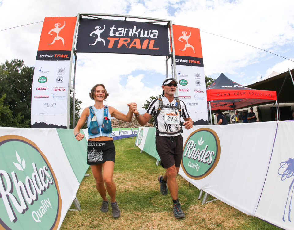 Katja Sogot and Donald Mouton celerate crossing the finish line during Stage 2 of the Tankwa Trail on the 18th of February 2017. Photo by Oakpics.com.